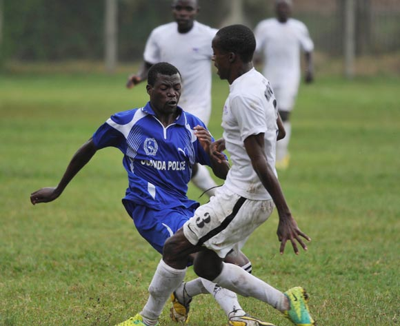 Michael Katosi (L) of Police FC being tackled by Simon Namwanja (R) of Proline FC during their 2013 Fufa Super League game at Lugogo Stadium, Kampala on 10 September 2013 ©Ismail Kezaala/BackpagePix