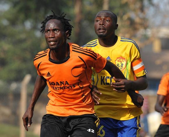 Osman Wejuli of Soana FC being challenged by Fahad Kawooya of KCCA FC during their 2013 Fufa Super League game at Lugogo Stadium, Kampala on 13 September 2013 ©Ismail Kezaala/BackpagePix