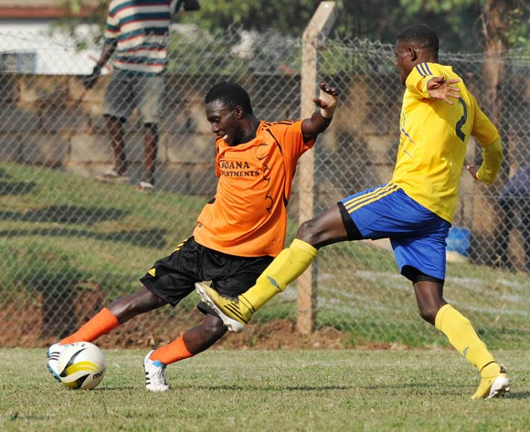 Francis Olaki (L) of Soana FC being challenged by Richard Malinga (R) of KCCA FC during their 2013 Fufa Super League game at Lugogo Stadium, Kampala on 13 September 2013 ©Ismail Kezaala/BackpagePix