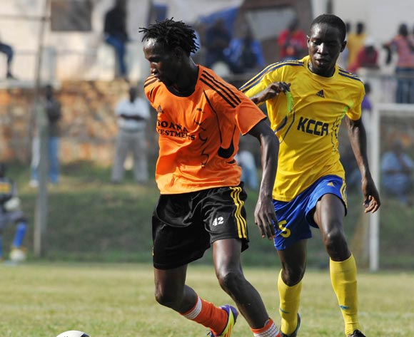Osman Wejuli of Soana FC being challenged by Hakim Senkumba of KCCA FC during their 2013 Fufa Super League game at Lugogo Stadium, Kampala on 13 September 2013 ©Ismail Kezaala/BackpagePix
