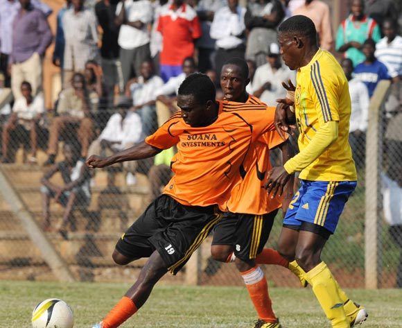 Francis Olaki of Soana FC being challenged by Richard Malinga of KCCA FC during their 2013 Fufa Super League game at Lugogo Stadium, Kampala on 13 September 2013 ©Ismail Kezaala/BackpagePix