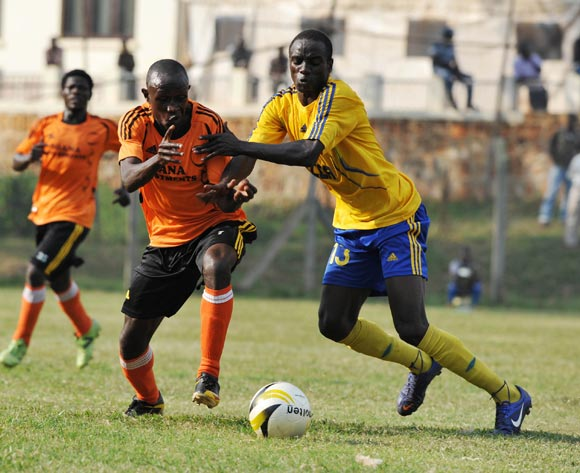 Siraje Turyamutebwa (L) of Soana FC being challenged by William Wadri (R) of KCCA FC during their 2013 Fufa Super League game at Lugogo Stadium, Kampala on 13 September 2013 ©Ismail Kezaala/BackpagePix
