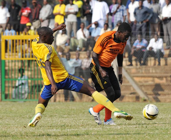 Francis Olaki of Soana FC being tackled by Fahad Kawooya of KCCA FC during their 2013 Fufa Super League game at Lugogo Stadium, Kampala on 13 September 2013 ©Ismail Kezaala/BackpagePix