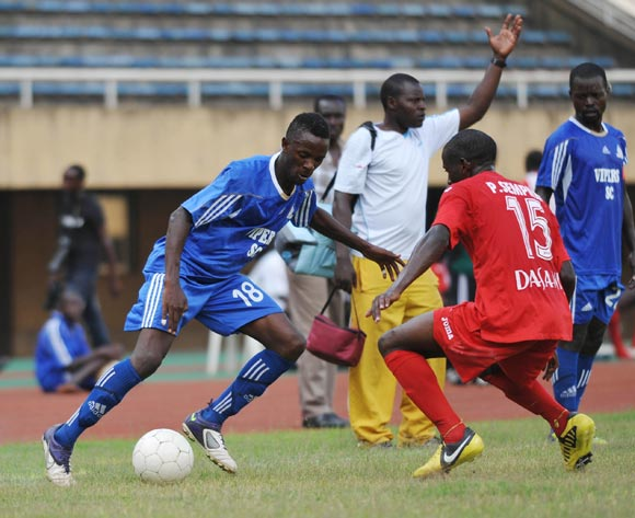 Juma Balinya of Vipers FC being challenged by Yasser Mugerwa of Victoria University FC during their 2013 Fufa Super League game at Mandela Stadium, Namboole, Kampala on 17 September 2013 ©Ismail Kezaala/BackpagePix