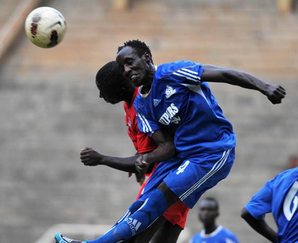 Edward Ssali (R) of Vipers FC being challenged by Isaac Muleme (L) of Victoria University FC during their 2013 Fufa Super League game at Mandela Stadium, Namboole, Kampala on 17 September 2013 ©Ismail Kezaala/BackpagePix