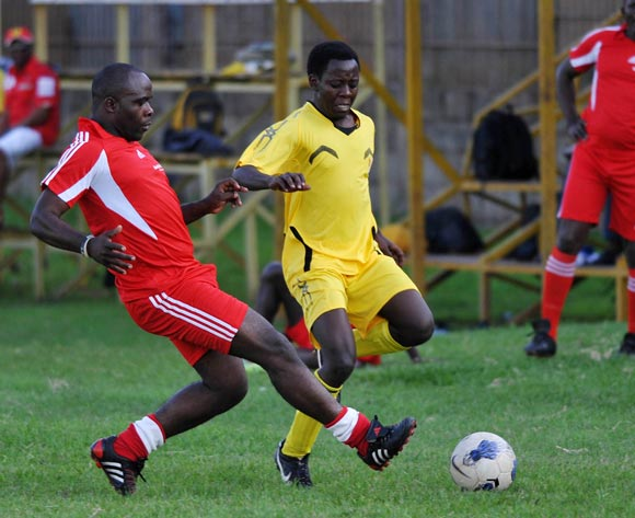 James Sekandi (L) of Monitor Publications Limited (MPL) challenges Allan Mwesiga (R) of MTN Uganda during their friendly game at Legends Ground Lugogo, Kampala on 06 October 2013 ©Ismail Kezaala/BackpagePix