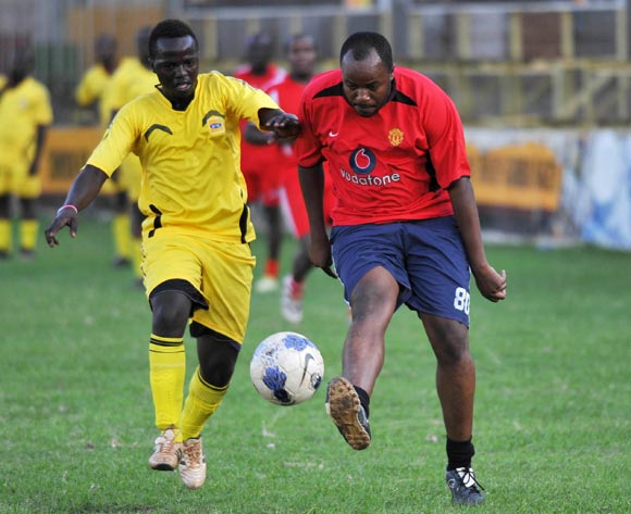 Siraje Wardy (L) of MTN Uganda challenges Mark Namanya (R) of Monitor Publications Limited (MPL) during their friendly game at Legends Ground Lugogo, Kampala on 06 October 2013 ©Ismail Kezaala/BackpagePix