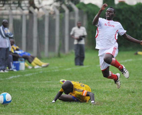 Julius Ntambi of Kiira Young FC jumps from a tackle from Rogers Arolo of KCCA FC during their Fufa Super League game at Lugogo Stadium, Kampala on 25 October 2013 ©Ismail Kezaala/BackpagePix