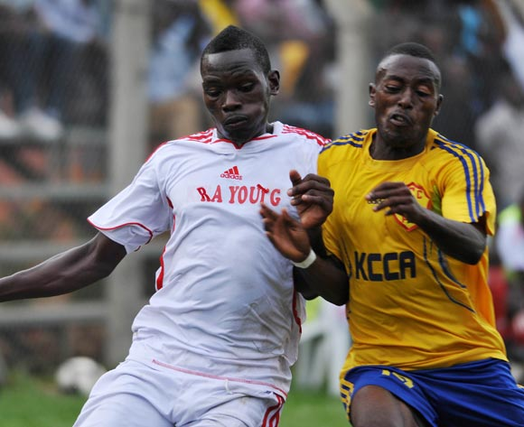 Brian Majwega (R) of KCCA FC challenges Julius Ntambi (L) of Kiira Young FC during their Fufa Super League game at Lugogo Stadium, Kampala on 25 October 2013 ©Ismail Kezaala/BackpagePix