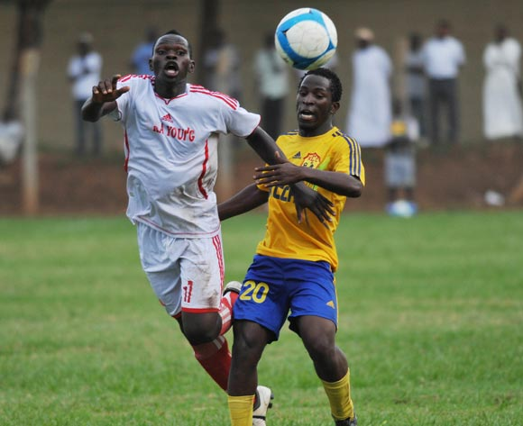 Steven Bengo (R) of KCCA FC challenges Julius Ntambi (L) of Kiira Young FC during their Fufa Super League game at Lugogo Stadium, Kampala on 25 October 2013 ©Ismail Kezaala/BackpagePix