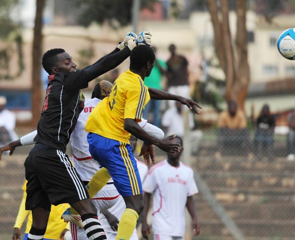 Nicholas Sebwato (R), KCCA FC goal keeper punches the ball away during their Fufa Super League game against Kiira Young FC at Lugogo Stadium, Kampala on 25 October 2013 ©Ismail Kezaala/BackpagePix