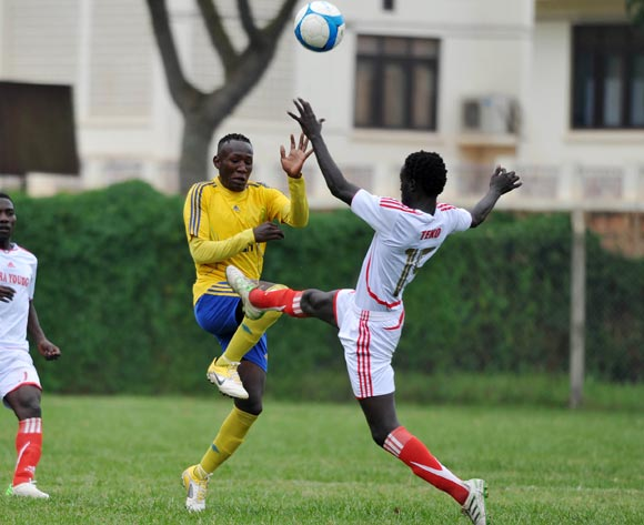 Derrick Teko (R) of Kiira Young FC tackles Tom Masiko (L) of KCCA FC during their Fufa Super League game at Lugogo Stadium, Kampala on 25 October 2013 ©Ismail Kezaala/BackpagePix