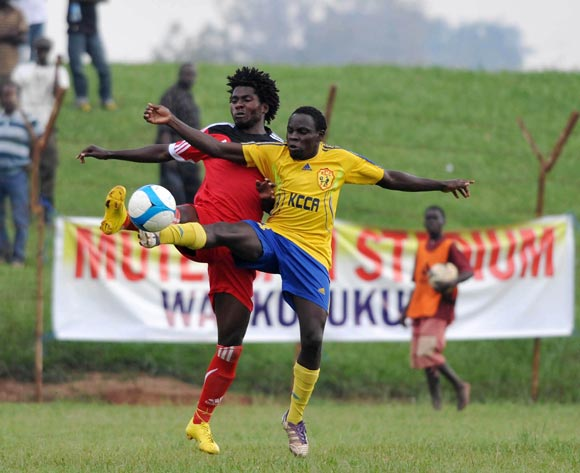 Ivan Ntege (R) of KCCA FC challenges Allan Kyambadde (L) of Express FC during their Fufa Super League game at Wankulukuku Stadium, Kampala on 01 November 2013 ©Ismail Kezaala/BackpagePix