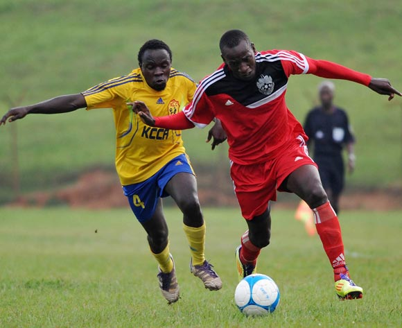 Ivan Ntege (L) of KCCA FC challenges Musa Mukasa (R) of Express FC during their Fufa Super League game at Wankulukuku Stadium, Kampala on 01 November 2013 ©Ismail Kezaala/BackpagePix
