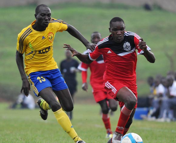 Ibrahim Kizza (L) of KCCA FC challenges Umar Ngobi (R) of Express FC during their Fufa Super League game at Wankulukuku Stadium, Kampala on 01 November 2013 ©Ismail Kezaala/BackpagePix