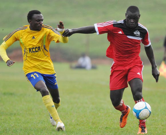Michael Birungi (L) of KCCA FC challenges Ivan Sserunkuma (R) of Express FC during their Fufa Super League game at Wankulukuku Stadium, Kampala on 01 November 2013 ©Ismail Kezaala/BackpagePix