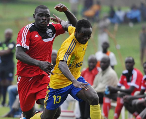Ivan Sserunkuma (L) of Express FC challenges William Wadri (R) of KCCA FC  during their Fufa Super League game at Wankulukuku Stadium, Kampala on 01 November 2013 ©Ismail Kezaala/BackpagePix