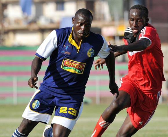 Julius Mutyaba (R) of Express FC challenges Anthony Bongole (L) of Bright Stars FC during their Fufa Super League game at Nakivubo Stadium, Kampala on 05 November 2013 ©Ismail Kezaala/BackpagePix