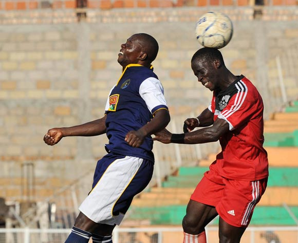 Abubakar Tabula (L) of Bright Stars FC heads the ball as Isaac Okolimo (R) of Express FC heads it further during their Fufa Super League game at Nakivubo Stadium, Kampala on 05 November 2013 ©Ismail Kezaala/BackpagePix