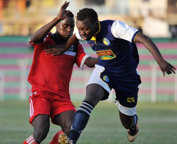 Ramathan Yakub (R) of Bright Stars FC challenges Godfrey Lwesiba (L) of Express FC during their Fufa Super League game at Nakivubo Stadium, Kampala on 05 November 2013 ©Ismail Kezaala/BackpagePix