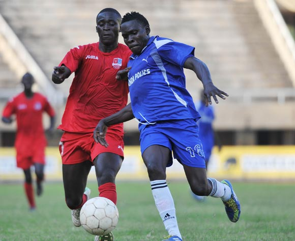 Daniel Nsubuga of SC Victoria University challenges Moses Kimuli of Uganda Police FC during their Fufa Super League game at the Mandela Stadium, Namboole, Kampala on 19 November 2013 ©Ismail Kezaala/BackpagePix