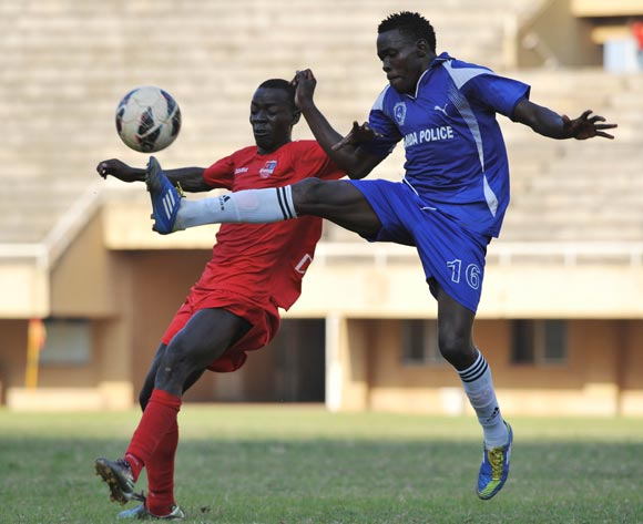 Godfrey Kateregga of SC Victoria University set to head the ball as Moses Kimuli (R) of Uganda Police FC blocks it during their Fufa Super League game at the Mandela Stadium, Namboole, Kampala on 19 November 2013 ©Ismail Kezaala/BackpagePix