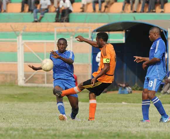 Timothy Musinguzi of Soana FC kicks the ball as Ronald Muganga of SC Villa challenges him during the 2014 Fufa Super League at Nakivubo Stadium, Kampala on 07 February 2014 ©Ismail Kezaala/BackpagePix