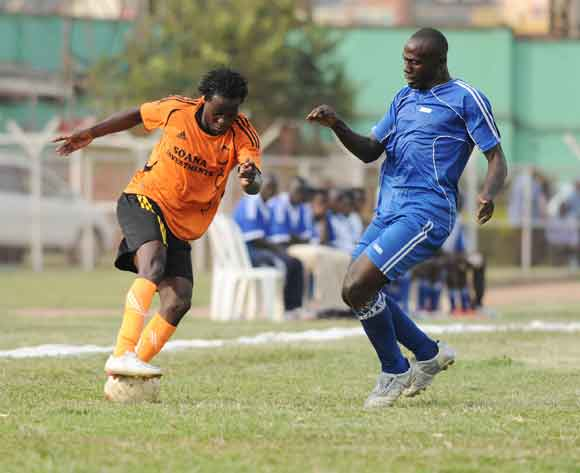 Arthur Mukisa of SC Villa challenges Daniel Wagaruka (L) of Soana FC during the 2014 Fufa Super League at Nakivubo Stadium, Kampala on 07 February 2014 ©Ismail Kezaala/BackpagePix
