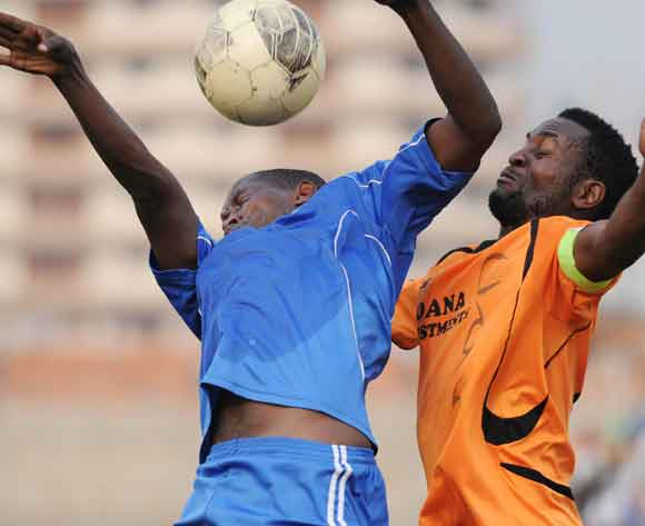 Timothy Musinguzi of Soana FC challenges Ronald Muganga of SC Villa as they head the ball during the 2014 Fufa Super League at Nakivubo Stadium, Kampala on 07 February 2014 ©Ismail Kezaala/BackpagePix