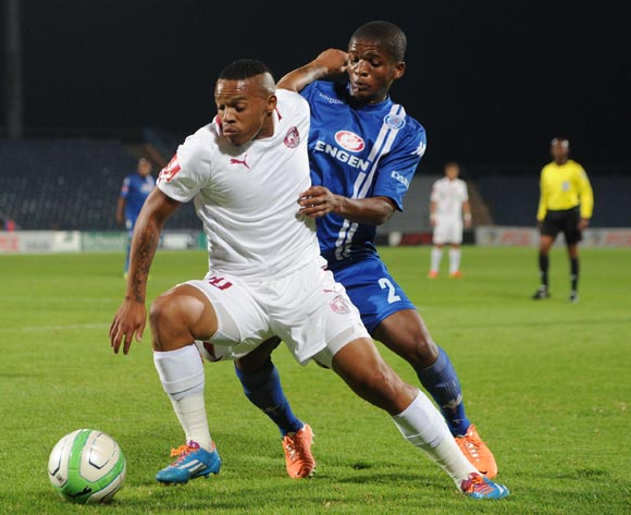 Edward Manqele of Moroka Swallows battles with Thabo Moloi of Supersport United during an Absa Premiership match between Moroka Swallows and Supersport United on the 19 February 2014 at Dobsonville Stadium