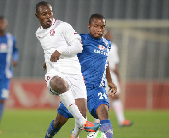 Asavela Mbekile of Moroka Swallows battles with David Mathebula of Supersport United during an Absa Premiership match between Moroka Swallows and Supersport United on the 19 February 2014 at Dobsonville Stadium