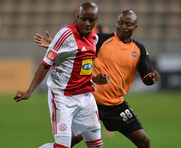 Bantu Mzwakali of Ajax Cape Town battles for the ball with Sipho Jembula of Polokwane City during the Absa Premiership 2013/14 football match between Ajax Cape Town and Polokwane City at Athlone Stadium, Cape Town on 28 February 2014
