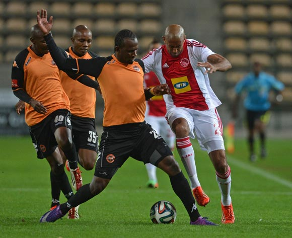 Nathan Paulse of Ajax Cape Town battles for the ball with Thapelo Tshilo of Polokwane City during the Absa Premiership 2013/14 football match between Ajax Cape Town and Polokwane City at Athlone Stadium, Cape Town on 28 February 2014