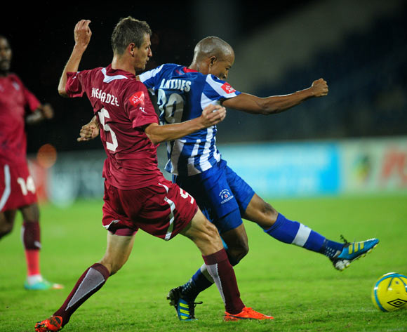 Kurt Lentjies of Maritzburg United battles Giorgi Nergadze of Moroka Swallows during the Absa Premiership 2013/14 football match between Maritzburg United v Moroka Swallows at the Harry Gwala Stadium in Pietermaritzburg , Kwa-Zulu Natal on the 28th of Feb