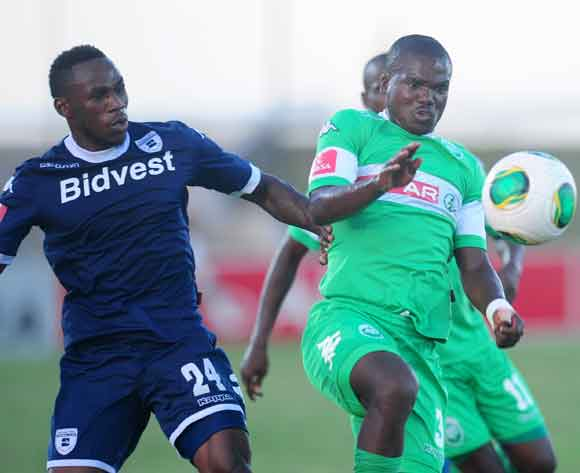 Goodman Dlamini ofAmaZulu battling Onismor Bhasera of Bidvest Wits during the Absa Premiership 2013/14 football match between AmaZulu and Bidvest Wits at the Princess Magogo Stadium in Durban, Kwa-Zulu Natal on the 15th of February 2014  ©Sabelo Mngoma/Ba