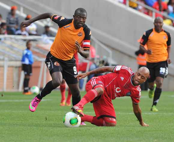 Oupa Manyisa of Orlando Pirates challenged by Esau Kanyenda of Polokwane City during the Absa Premiership football match between Polokwane City and Orlando Pirates at the Peter Mokaba Stadium, Limpopo on the 15 February 2014 ©Samuel Shivambu/BackpagePix