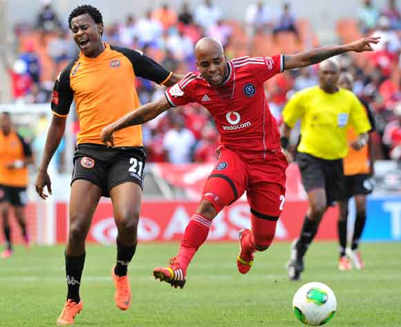 Oupa Manyisa of Orlando Pirates challenged by Kabelo Lichaba of Polokwane City during the Absa Premiership football match between Polokwane City and Orlando Pirates at the Peter Mokaba Stadium, Limpopo on the 15 February 2014 ©Samuel Shivambu/BackpagePix