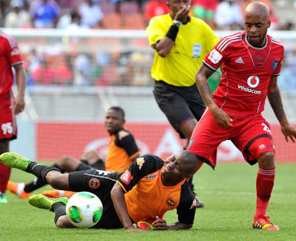Sipho Jembula of Polokwane City challenged by Oupa Manyisa of Orlando Pirates during the Absa Premiership football match between Polokwane City and Orlando Pirates at the Peter Mokaba Stadium, Limpopo on the 15 February 2014 ©Samuel Shivambu/BackpagePix