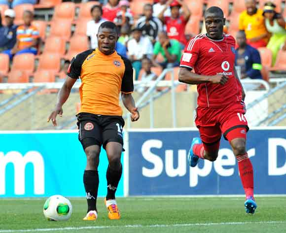 Puleng Tlolane of Polokwane City challenged by Lucky Lekgwathi of Orlando Pirates during the Absa Premiership football match between Polokwane City and Orlando Pirates at the Peter Mokaba Stadium, Limpopo on the 15 February 2014 ©Samuel Shivambu/BackpageP