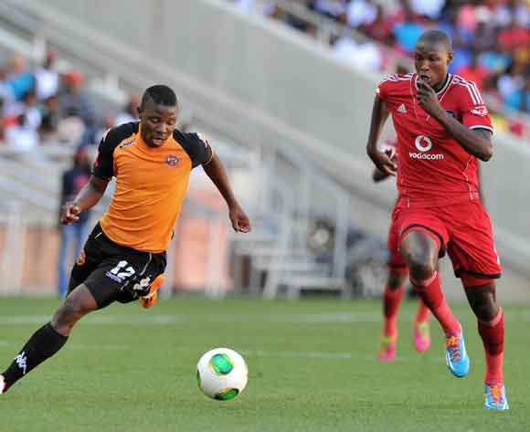 Puleng Tlolane of Polokwane City challenged by Ayanda Gcaba of Orlando Pirates during the Absa Premiership football match between Polokwane City and Orlando Pirates at the Peter Mokaba Stadium, Limpopo on the 15 February 2014 ©Samuel Shivambu/BackpagePix