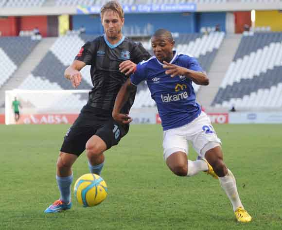 Rheece Evans of Maritzburg United battles with Thabo Qalinge of Black Aces during the Absa Premiership match between MP Black Aces and Maritzburg United at Mbombela Stadium in Pretoria on the 16 February 2014 ©Sydney Mahlangu/BackpagePix