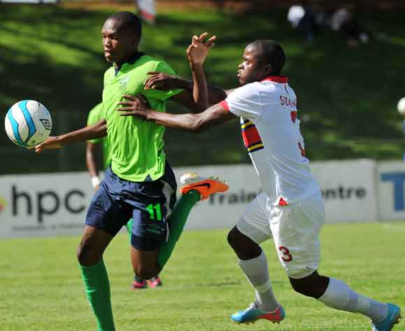 Mogakolodi Ngele of Platinum Stars challenged by Junior Sibande of University Pretoria during the Absa Premiership football match between University of Pretoria and Platinum Stars at the Tuks Stadium, Pretoria on the 16 February 2014 ©Samuel Shivambu/Back