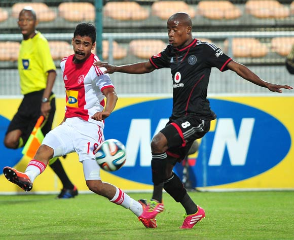 Abbubaker Mobara of Ajax Cape Town gets his cross on ahead of Thabo Matlaba of Orlando Pirates during the Absa Premiership 2013/14 game between Ajax Cape Town and Orlando Pirates at Athlone Stadium, Cape Town on 18 February 2014