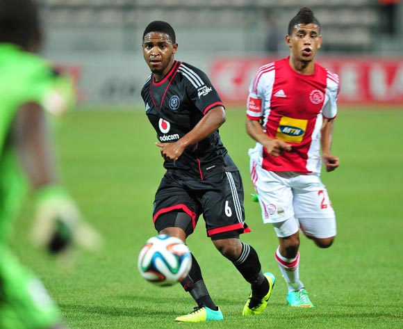 Thandani Ntshumayelo of Orlando Pirates gets the ball back to Senzo Meyiwa of Orlando Pirates under pressure from Keagan Dolly of Ajax Cape Town during the Absa Premiership 2013/14 game between Ajax Cape Town and Orlando Pirates at Athlone Stadium, Cape T