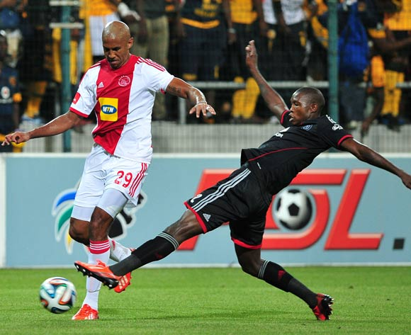 Ayanda Gcaba of Orlando Pirates makes a last ditch tackle on Nathan Paulse of Ajax Cape Town during the Absa Premiership 2013/14 game between Ajax Cape Town and Orlando Pirates at Athlone Stadium, Cape Town on 18 February 2014