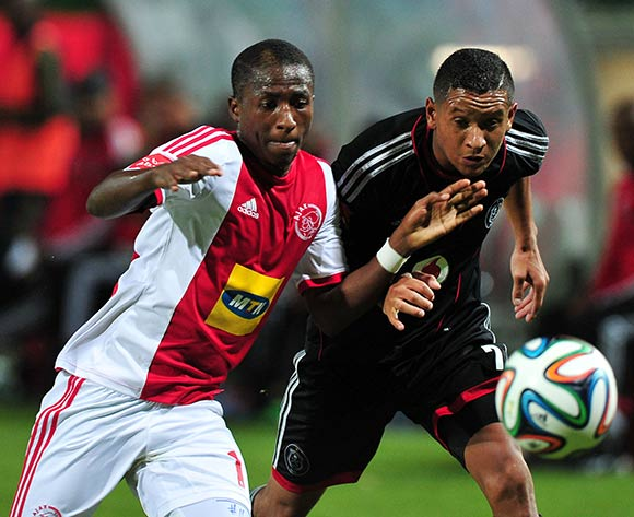 Stelio Ernesto of Ajax Cape Town and Daine Klate of Orlando Pirates battle for possession during the Absa Premiership 2013/14 game between Ajax Cape Town and Orlando Pirates at Athlone Stadium, Cape Town on 18 February 2014