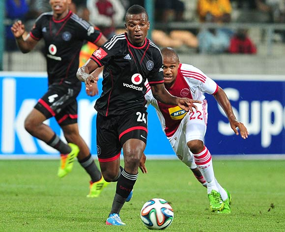Khethowakhe Masuku of Orlando Pirates goes past Aidan Jenniker of Ajax Cape Town during the Absa Premiership 2013/14 game between Ajax Cape Town and Orlando Pirates at Athlone Stadium, Cape Town on 18 February 2014