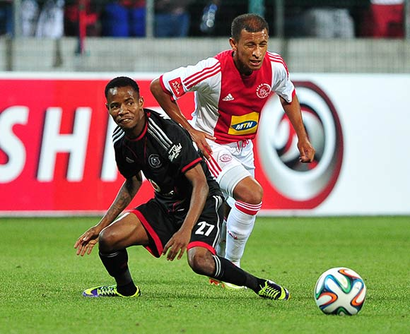 Joseph Malongoane of Orlando Pirates and Nazeer Allie of Ajax Cape Town battle for possession during the Absa Premiership 2013/14 game between Ajax Cape Town and Orlando Pirates at Athlone Stadium, Cape Town on 18 February 2014