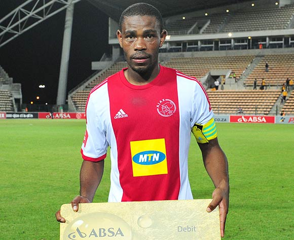 Thulani Hlatshwayo of Ajax Cape Town with the Absa Man of the Match award during the Absa Premiership 2013/14 game between Ajax Cape Town and Orlando Pirates at Athlone Stadium, Cape Town on 18 February 2014