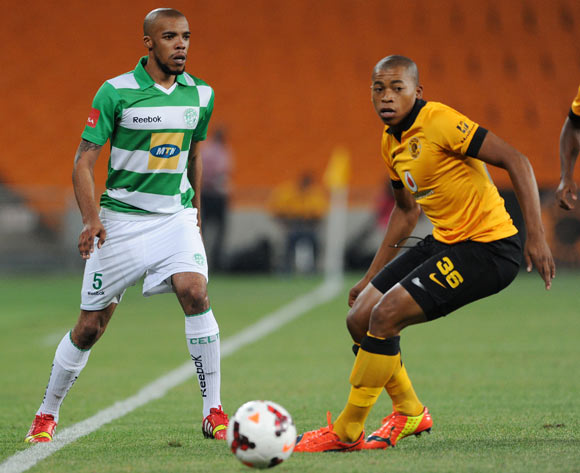 Wandisile Letlabika of Bloemfontein Celtic challenged by Simphiwe Mtsweni of Kaizer Chiefs  during the Absa Premiership 2013/14 match between Kaizer Chiefs and Bloemfontein Celtic at FNB Stadium in Johannesburg on the 19 February 2014